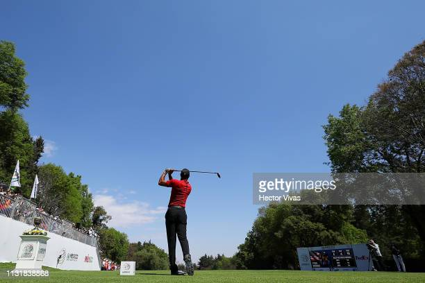 Tiger Woods of the United States plays his shot from the first tee during the final round of World Golf ChampionshipsMexico Championship at Club de...