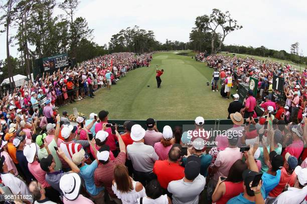 Tiger Woods of the United States plays his shot from the first tee during the final round of THE PLAYERS Championship on the Stadium Course at TPC...