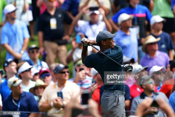 Tiger Woods of the United States plays his shot from the fourth tee during the first round of the 2018 PGA Championship at Bellerive Country Club on...
