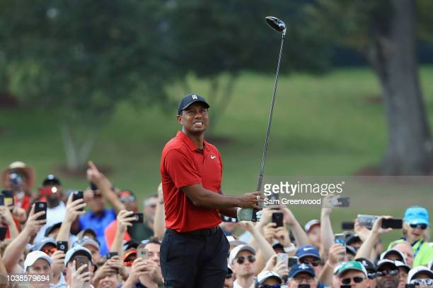 Tiger Woods of the United States plays his shot from the fourth tee during the final round of the TOUR Championship at East Lake Golf Club on...