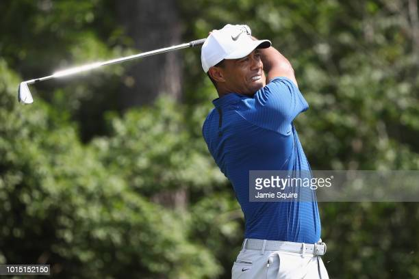 Tiger Woods of the United States plays his shot from the ninth tee during the third round of the 2018 PGA Championship at Bellerive Country Club on...