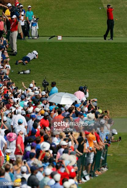 Tiger Woods of the United States plays his shot from the ninth tee during the final round of the TOUR Championship at East Lake Golf Club on...