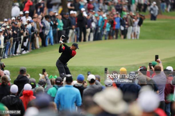 Tiger Woods of the United States plays his shot from the ninth tee during the final round of The PLAYERS Championship on The Stadium Course at TPC...