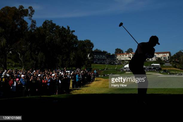 Tiger Woods of the United States plays his shot from the ninth tee during the first round of the Genesis Invitational on February 13 2020 in Pacific...