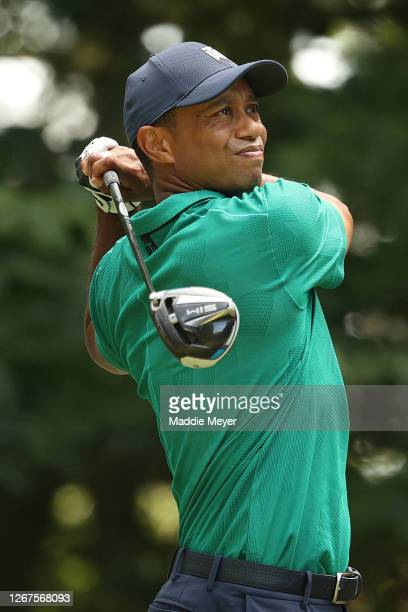 Tiger Woods of the United States plays his shot from the ninth tee during the second round of The Northern Trust at TPC Boston on August 21, 2020 in...