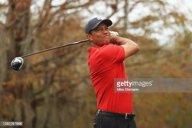 Tiger Woods of the United States plays his shot from the ninth tee during the final round of the PNC Championship at the Ritz-Carlton Golf Club...