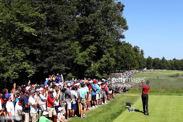 Tiger Woods of the United States plays his shot from the second tee during the final round of the Dell Technologies Championship at TPC Boston on...