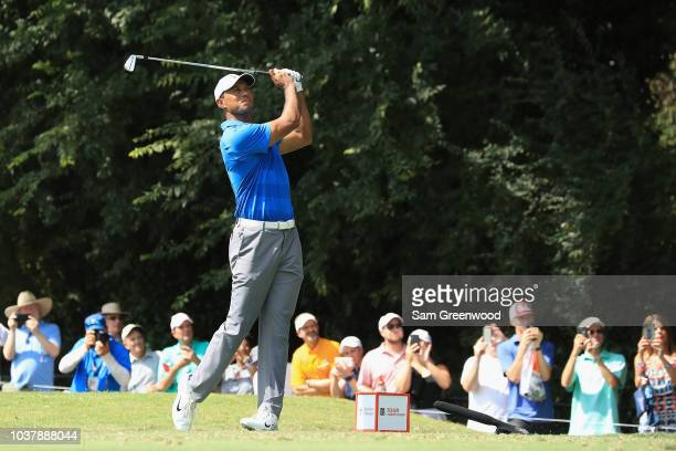 Tiger Woods of the United States plays his shot from the second tee during the third round of the TOUR Championship at East Lake Golf Club on...