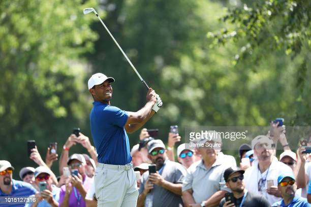 Tiger Woods of the United States plays his shot from the seventh tee during the third round of the 2018 PGA Championship at Bellerive Country Club on...