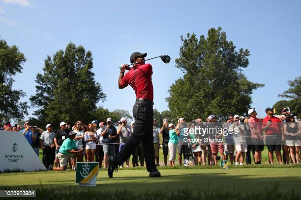 Tiger Woods of the United States plays his shot from the seventh tee during the final round of The Northern Trust on August 26 2018 at the Ridgewood...