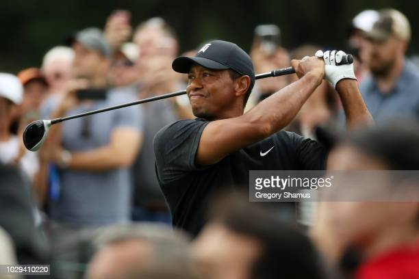Tiger Woods of the United States plays his shot from the seventh tee during the third round of the BMW Championship at Aronimink Golf Club on...