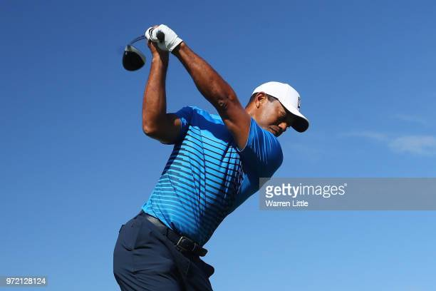 Tiger Woods of the United States plays his shot from the sixth tee during a practice round prior to the 2018 US Open at Shinnecock Hills Golf Club on...