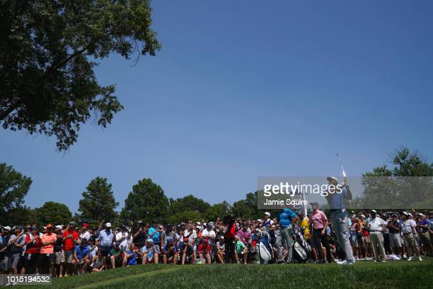 Tiger Woods of the United States plays his shot from the sixth tee during the third round of the 2018 PGA Championship at Bellerive Country Club on...