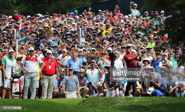 Tiger Woods of the United States plays his shot from the sixth tee during the final round of the 2018 PGA Championship at Bellerive Country Club on...