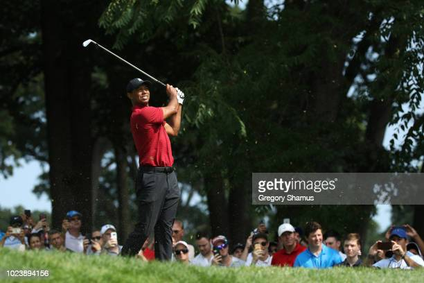 Tiger Woods of the United States plays his shot from the sixth tee during the final round of The Northern Trust on August 26 2018 at the Ridgewood...