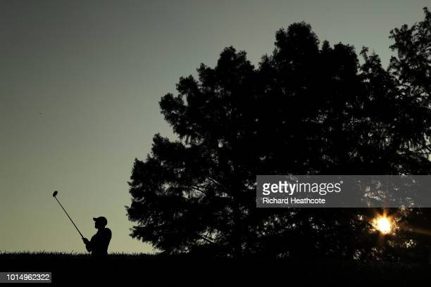 Tiger Woods of the United States plays his shot from the tenth tee during the continuation of the weather delayed second round of the 2018 PGA...