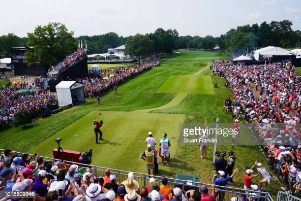 Tiger Woods of the United States plays his shot from the tenth tee during the final round of the 2018 PGA Championship at Bellerive Country Club on...
