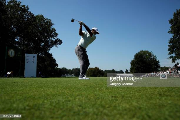 Tiger Woods of the United States plays his shot from the tenth tee during the first round of the BMW Championship at Aronimink Golf Club on September...
