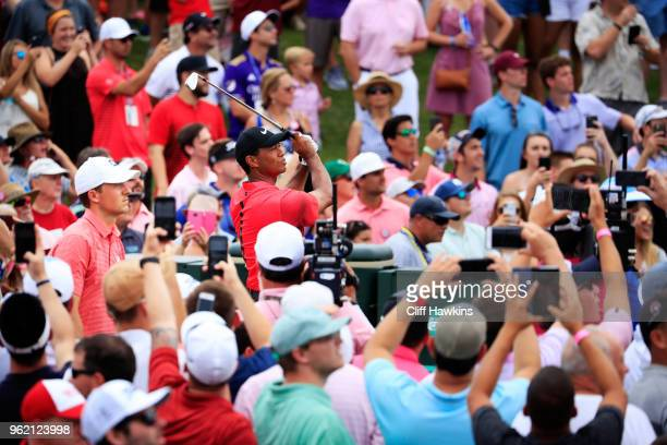 Tiger Woods of the United States plays his shot from the third tee as Jordan Spieth of the United States looks on during the final round of THE...