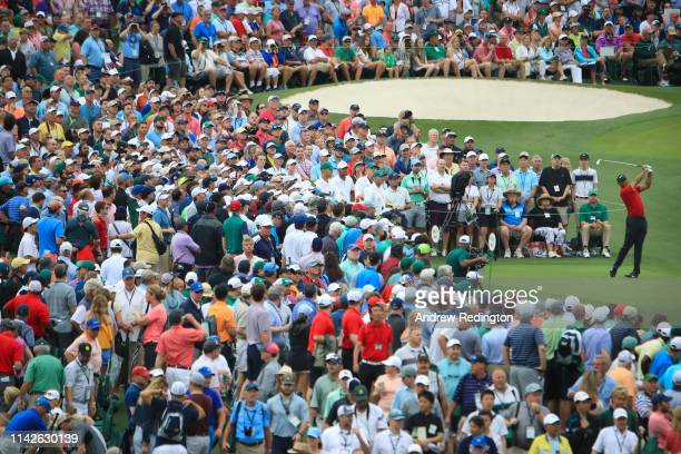 Tiger Woods of the United States plays his shot from the third tee during the final round of the Masters at Augusta National Golf Club on April 14,...