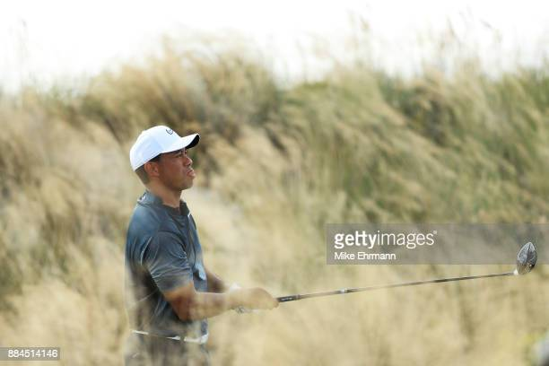 Tiger Woods of the United States plays his shot from the third tee during the third round of the Hero World Challenge at Albany Bahamas on December 2...