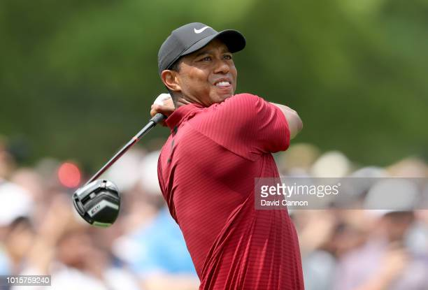 Tiger Woods of the United States plays his tee shot on the fourth hole during the final round of the 100th PGA Championship at the Bellerive Country...