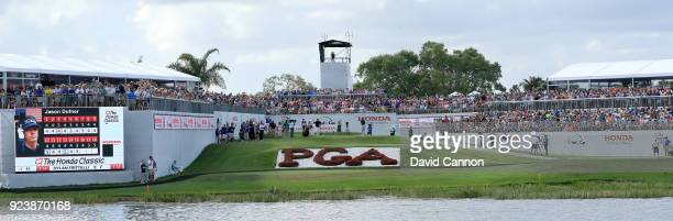 Tiger Woods of the United States plays his tee shot on the par 3 17th hole during the third round of the 2018 Honda Classic on The Champions Course...