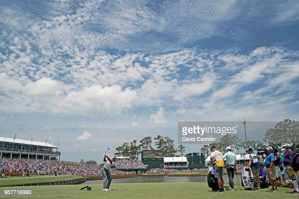 Tiger Woods of the United States plays his tee shot on the par 3, 17th hole during the third round of the THE PLAYERS Championship on the Stadium...