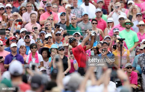 Tiger Woods of the United States plays his tee shot on the par 3 third hole in front of a large gallery during the final round of the THE PLAYERS...