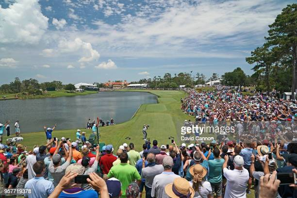 Tiger Woods of the United States plays his tee shot on the par 4 18th hole during the third round of the THE PLAYERS Championship on the Stadium...