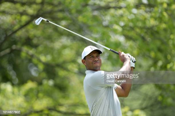 Tiger Woods of the United States plays his tee shot on the second hole during the second round of the 100th PGA Championship at the Bellerive Country...