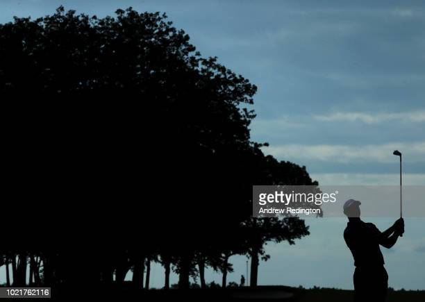 Tiger Woods of the United States plays his third shot on the 13th hole during the first round of The Northern Trust on August 23 2018 at the...