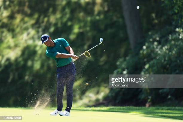 Tiger Woods of the United States plays his third shot on the 15th hole during the third round of The Memorial Tournament on July 18 2020 at Muirfield...