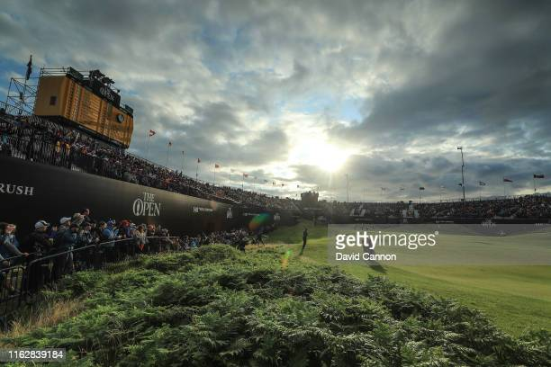 Tiger Woods of the United States plays his third shot on the 18th hole during the first round of the 148th Open Championship held on the Dunluce...