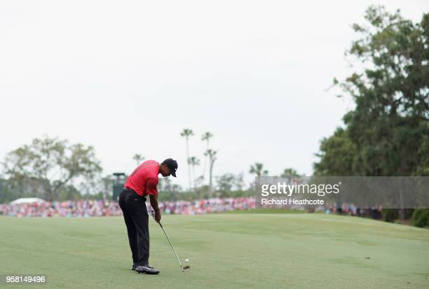 Tiger Woods of the United States plays his third shot on the second hole during the final round of THE PLAYERS Championship on the Stadium Course at...