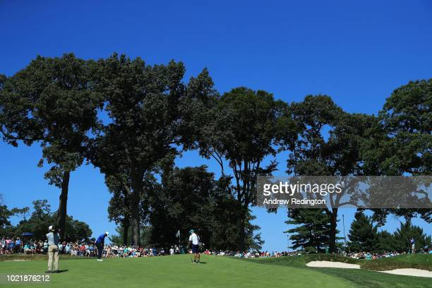 Tiger Woods of the United States plays his third shot on the seventh hole during the first round of The Northern Trust on August 23 2018 at the...