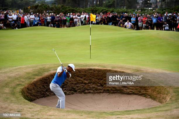 Tiger Woods of the United States plays out bunker by the 6th green during round one of the 147th Open Championship at Carnoustie Golf Club on July 19...
