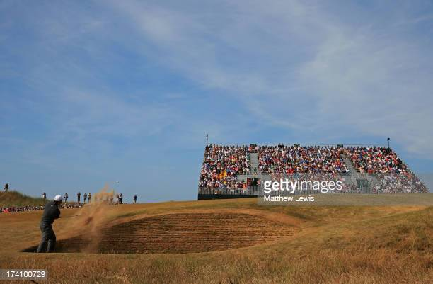 Tiger Woods of the United States plays out of a bunker on the fourth hole during the third round of the 142nd Open Championship at Muirfield on July...