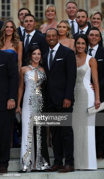 Tiger Woods of the United States poses with girlfriend Erica Herman before the Ryder Cup gala dinner at the Palace of Versailles ahead of the 2018...