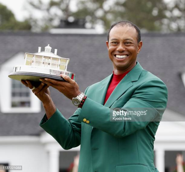 Tiger Woods of the United States poses with the Masters Trophy during a ceremony after winning the tournament in Augusta Georgia on April 14 2019 his...