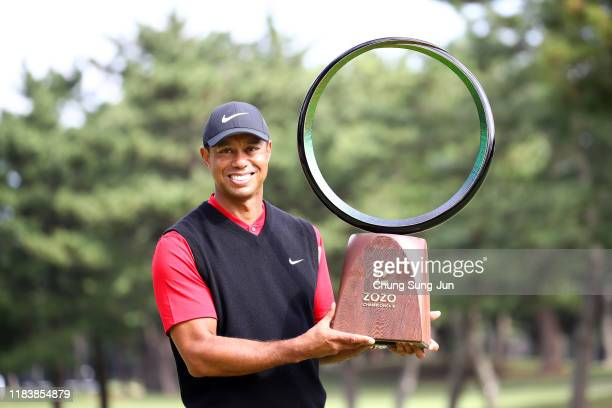 Tiger Woods of the United States poses with the trophy after the award ceremony following the final round of the Zozo Championship at Accordia Golf...