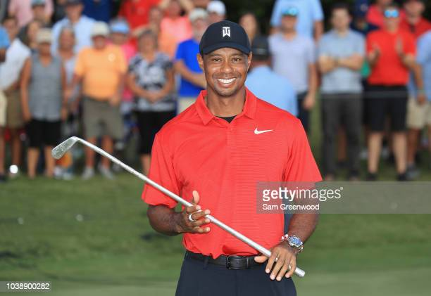 Tiger Woods of the United States poses with the trophy after winning the TOUR Championship at East Lake Golf Club on September 23 2018 in Atlanta...