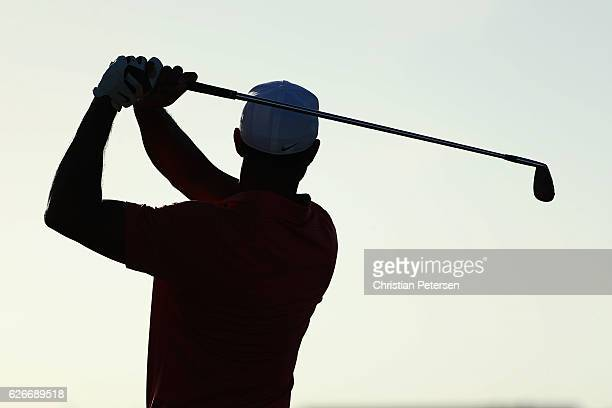 Tiger Woods of the United States practices on the driving range before the pro-am for the Hero World Challenge at Albany, The Bahamas on November 30,...
