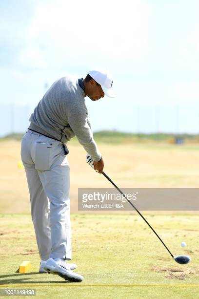 Tiger Woods of the United States practices on the driving range during previews to the 147th Open Championship at Carnoustie Golf Club on July 18...