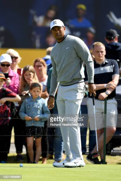Tiger Woods of the United States practices on the putting green area during previews to the 147th Open Championship at Carnoustie Golf Club on July...