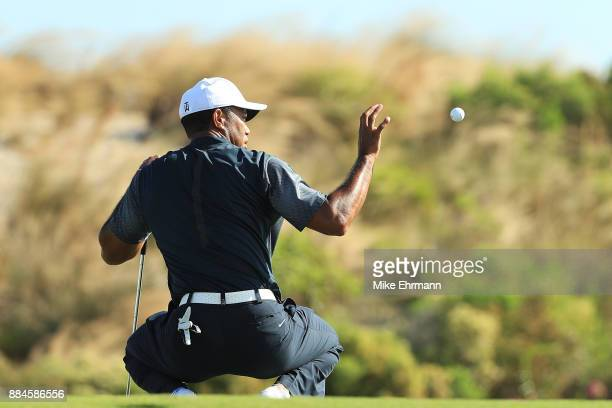 Tiger Woods of the United States prepares to play a shot during the third round of the Hero World Challenge at Albany Bahamas on December 2 2017 in...