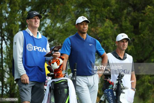 Tiger Woods of the United States prepares to play his shot from the 11th tee during the first round of the 2019 PGA Championship at the Bethpage...