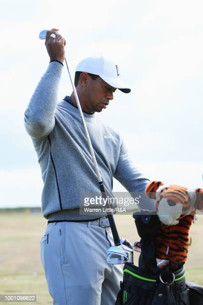 Tiger Woods of the United States prepares to practice on the driving range during previews to the 147th Open Championship at Carnoustie Golf Club on...