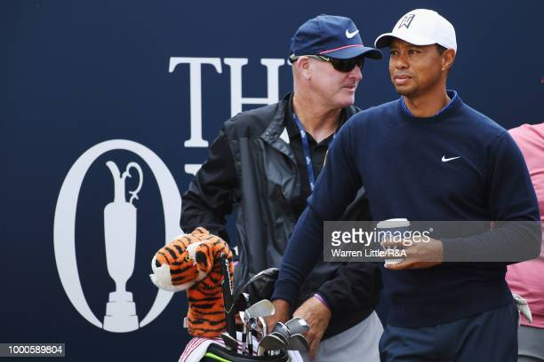 Tiger Woods of the United States prepares to tee off at the 1st hole while practicing during previews to the 147th Open Championship at Carnoustie...