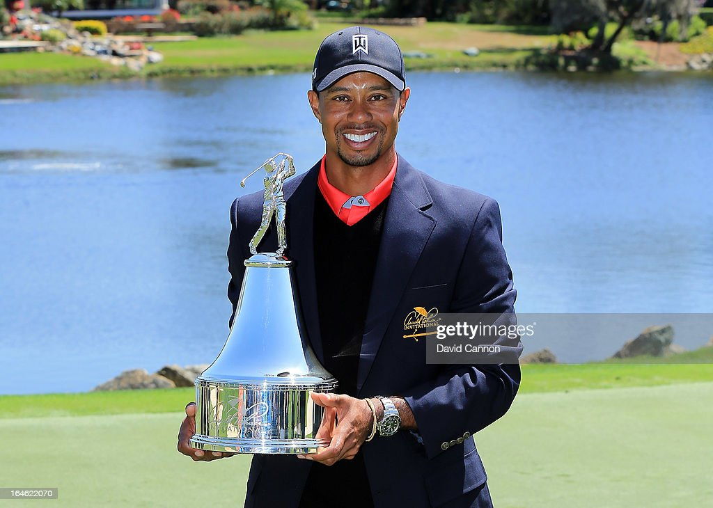 Tiger Woods of the United States proudly holds the trophy the win meant he re-gained the World's number one position after the final round of the 2013 Arnold Palmer Invitational Presented by Mastercard at Bay Hill Golf and Country Club on March 25, 2013 in Orlando, Florida.